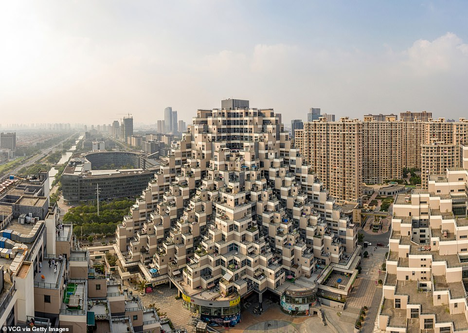 9078462-6699493-This_jaw_droppingly_wacky_pyramid_shaped_building_is_an_18_store-a-2_155023357...jpg